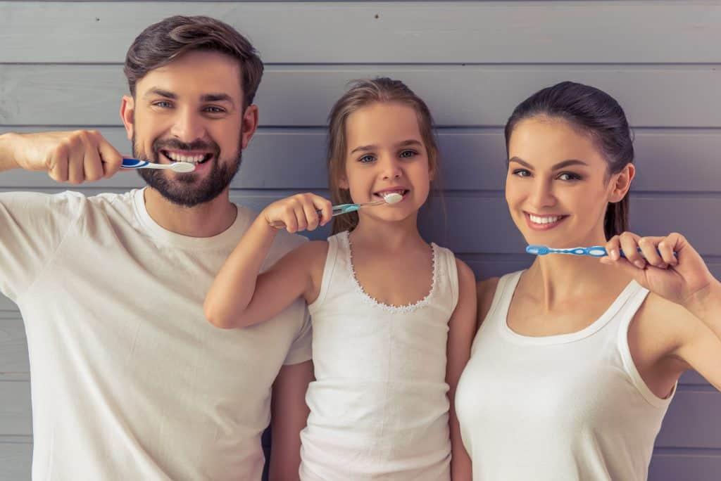 Family-brushing-their-teeth
