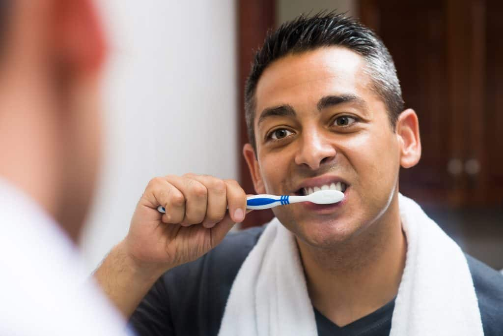 man brushing with teeth