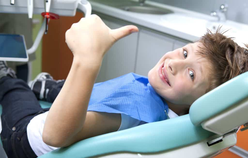 a happy child visiting the dentist
